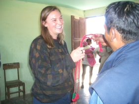 Summer Student receiving a Warak'a a Gift from Paulina
