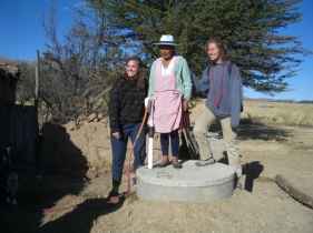 Widow Paulina with New Hand Pump and Summer Students Ariana and Anna